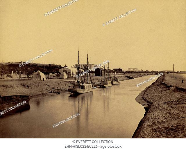 Small boats moored at water's edge to the Suez Canal at Ismailia. The Ismailia segment of the modern canal was completed in November 1862