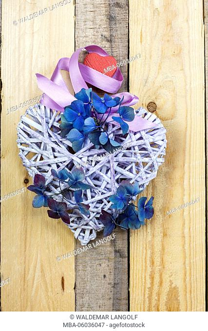 heart for decoration on wooden ground with hydrangea blossoms
