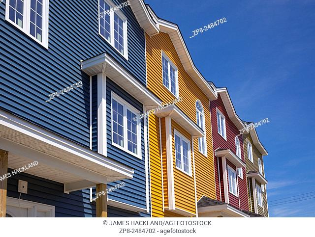 Four brand new colourful row houses on a sunny day in St. John's, Newfoundland, Canada