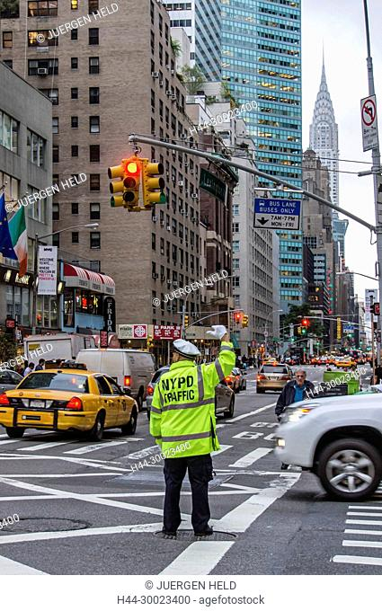 NYPD Traffic policemen at 57 th street, backgrounbd Chrysler building, New york City