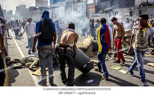 "CARACAS, VENEZUELA - APRIL 6: """"Protesters create barridacas against the (GNB)"""". Venezuelan opposition activists clashes wiht Police in Caracas on April 6"