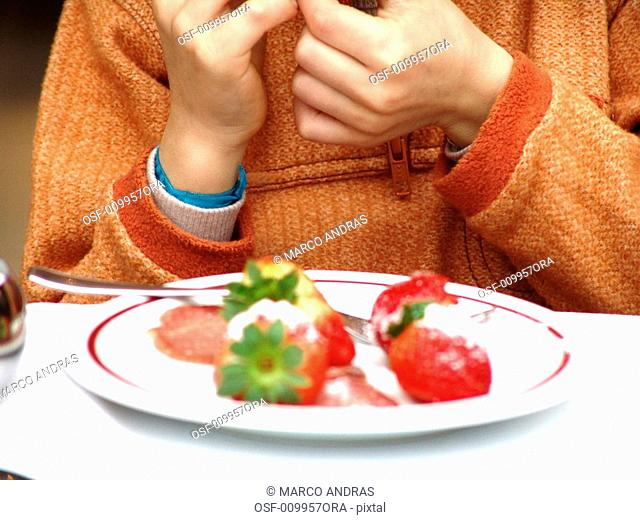 one person eating strawberries fruits