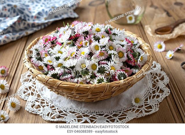 Common daisy flowers in a wicker basket