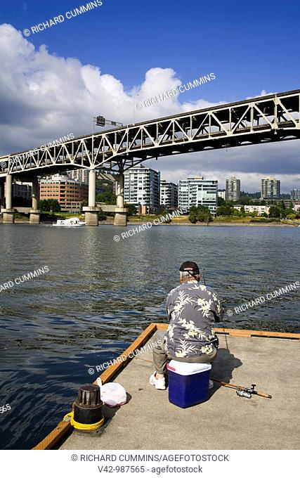Fishing the Willamette River near the Marquam Bridge in Portland, Oregon, USA