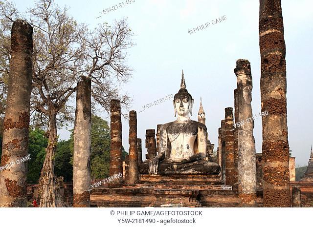 Buddha effigy at Wat Mahathat, Sukhothai Historical Park, Thailand