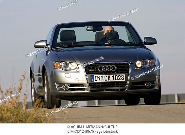 Audi A4 Convertible 3.0 TDI, silver, model year 2005-, driving, diagonal from the front, frontal view, country road, open top