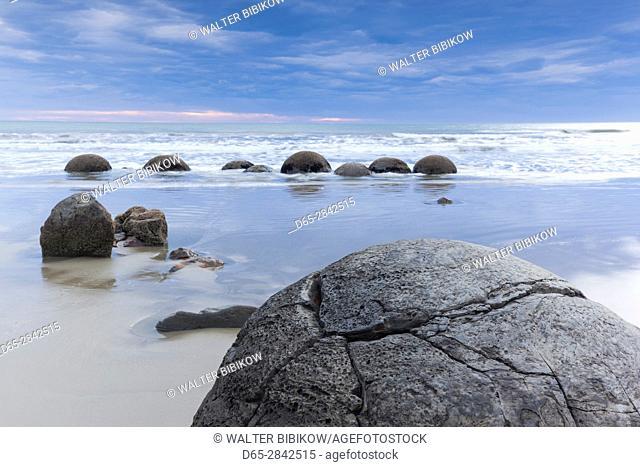 New Zealand, South Island, Otago, Moeraki, Moeraki Boulders also known as Te Kaihinaki, dawn