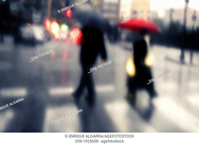 Padestrians in a rainy day, Valencia, Spain
