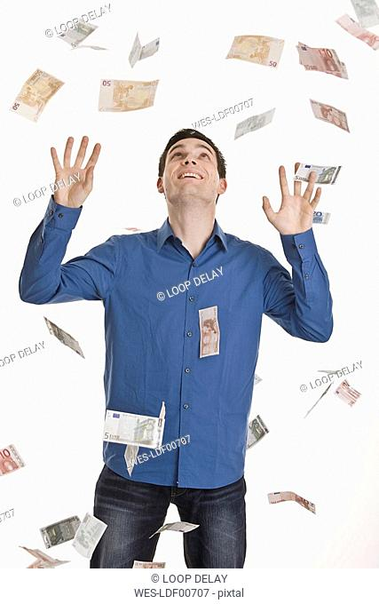 Businessman, Euro notes flying in air