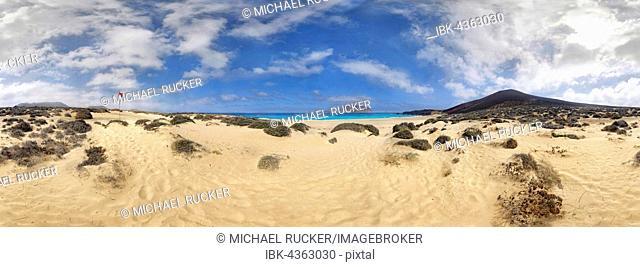 Sandy beach of Playa de las Conchas, volcano Monte Bermeja and island Monta Clara in the background, La Graciosa, Lanzarote, Canary Islands, Spain