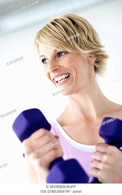 Woman with weights smiling