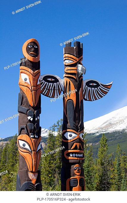 Two totem poles in the Jasper National Park, Alberta, Canada