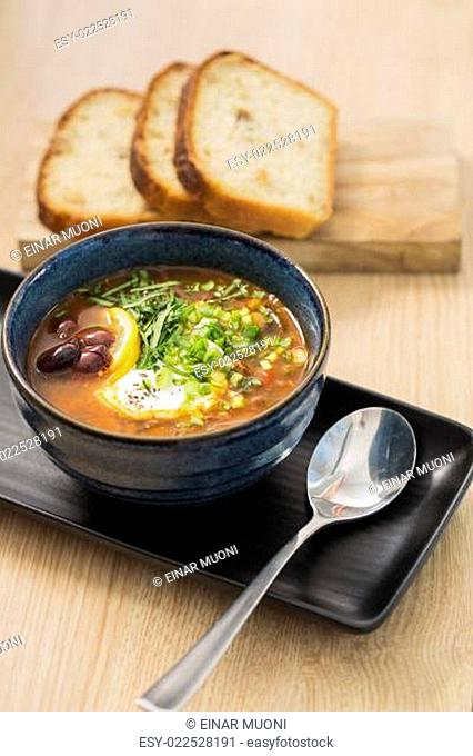 Bowl with delicious soup with bread