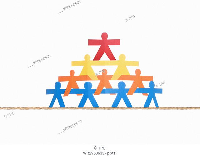 Working team standing on single rope, isolated on white background