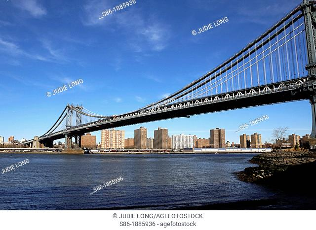 Manhattan Bridge and Lower East Side Skyline Seen from Brooklyn, NY, USA