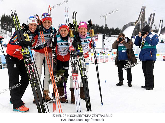 Marit Bjoergen, Astrid Uhrenholdt Jacobsen, Heidi Weng and Maiken Caspersen Falla (l-r) from Norway celebrate after the women's 4x5 km cross-country relay event...