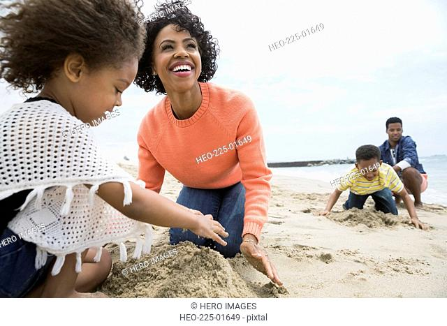 Family making sandcastles at beach
