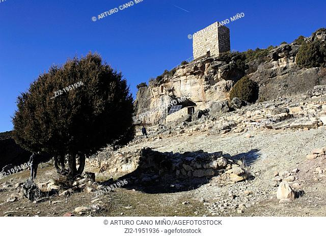 Entrance to the Cave of the Casares rock carvings and Arab watchtower. Riba de Saelices, Guadalajara, Spain