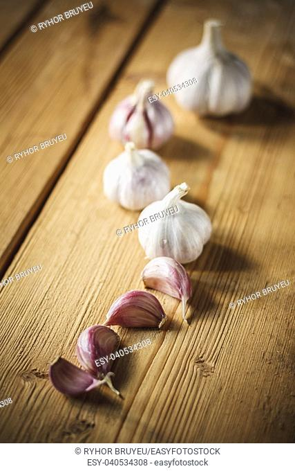 Healthy Organic Garlic Vegetables Whole And Cloves On The Wooden Background