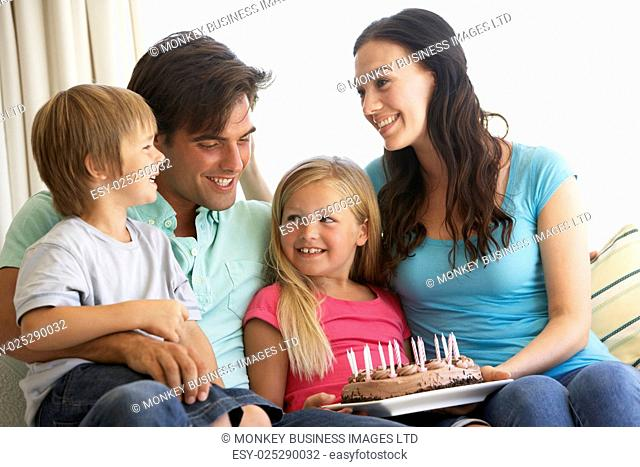 Family Group Celebrating Birthday At Home