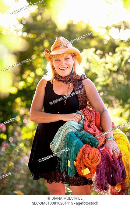 Woman holding basket full of yarn