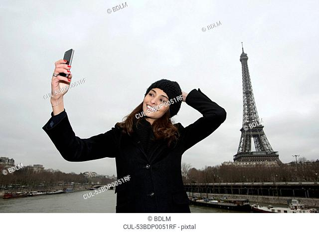Woman taking picture with cell phone