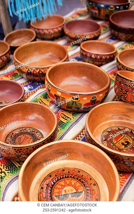 Close-up shot of wooden bowls at the open-air market in Pisac, Sacred Valley, Cusco Region, Peru, South America