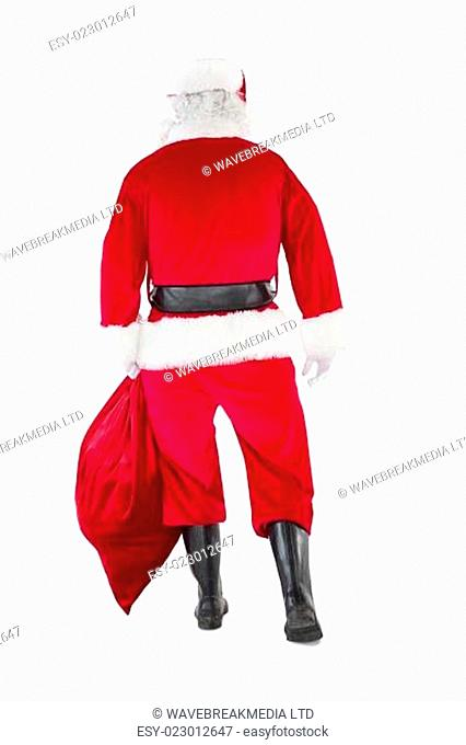 Rear view of santa claus holding a sack