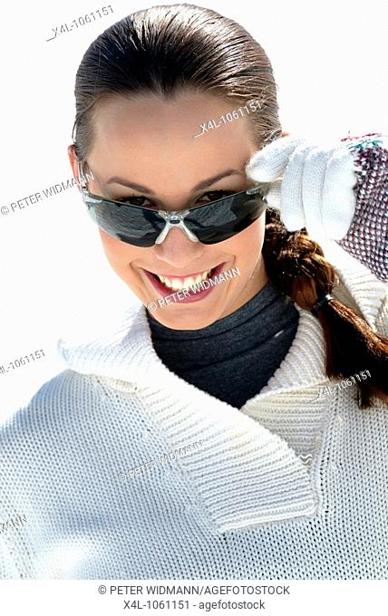 Young woman with sunglasses in the winter