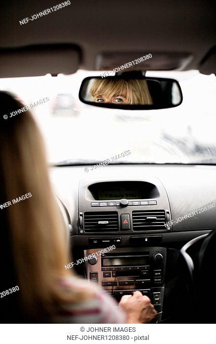Blonde woman driving car