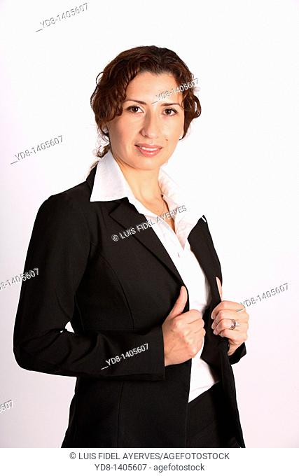 Young woman posing in the studio as an executive