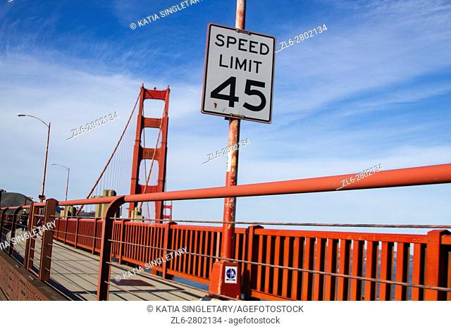 Speed limit 45 sign on the Sidewalk of the Golden gate bridge in San Francisco on a sunny afternoon, blue sky