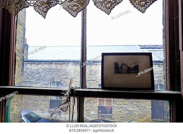 Close up of window with vintage image. Keighley, Bradford, West Yorkshire, UK
