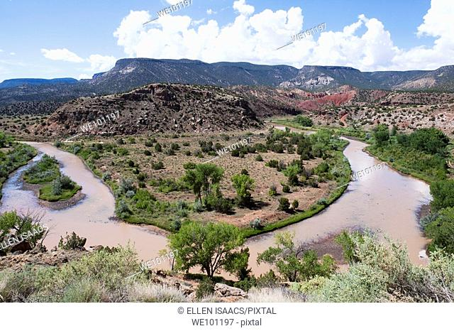 Sharp bend in Chama River winding among mesas of New Mexico outside Santa Fe near Abiquiu, where artist Georgia O'Keeffe lived and painted