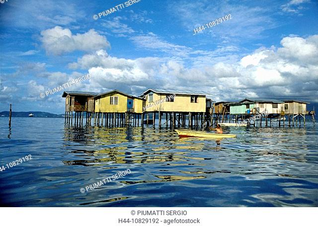 Malaysia, Asia, Borneo, Sabah, Mengkabong Water Village, village, houses, homes, stilts, stilt houses, fishermen, boat