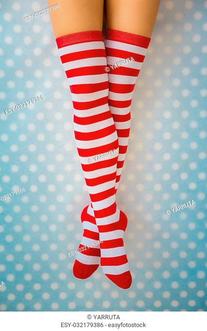 Sexy Santa woman legs. Christmas holiday concept. Top view