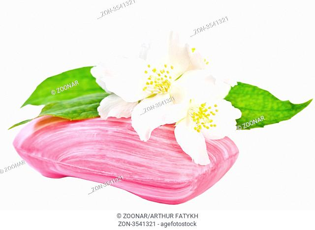 Pink soap with flowers jasmine. Isolated on white background