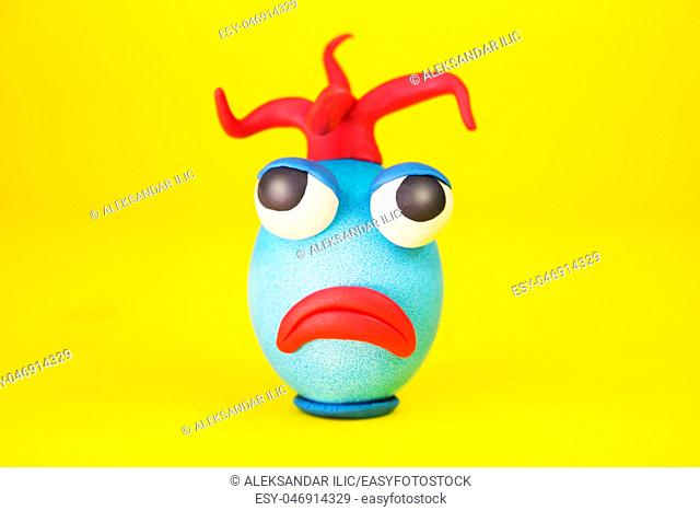 Easter Egg Cartoonish Character With Plasticine Eyes, Mouth and Hair Having an Expressive Face