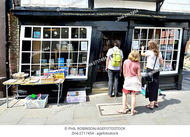 Canterbury, Kent, UK. Bookshop in Sir John Boys House / Crooked House (17thC) at 28 Palace Street - house slipped sideways during a rebuilding of the chimney