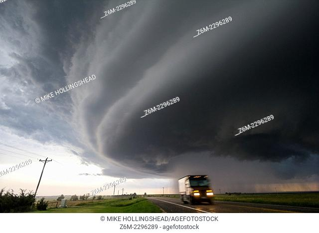 Supercell storm moves north of McCook Nebraska as a UPS driver zooms through falling hail stones