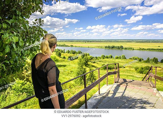 Blondie woman in the Oka river in the vicinity of the village of Konstantinovo, Ryazan region