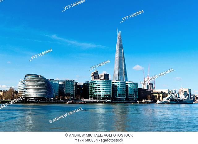 The Shard and City Hall amongst new buildings on the south bank of the river Thames  London