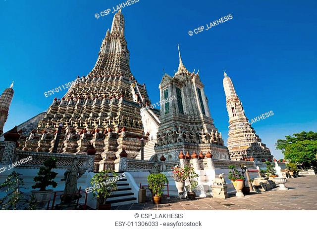 Wat Arun or Temple of Dawn over blue sky