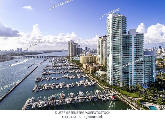 Florida, Miami Beach, South Pointe, aerial overhead bird's eye view above, Biscayne Bay, marina boats, Murano At Portofino, high rise condominium buildings