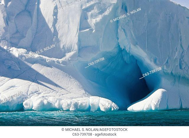 Whimsical ice caves formed by wind and sea in this iceberg detail in and around the Antarctic Peninsula during the summer months  More icebergs are being...