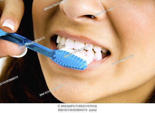 Close up of woman brushing teeth