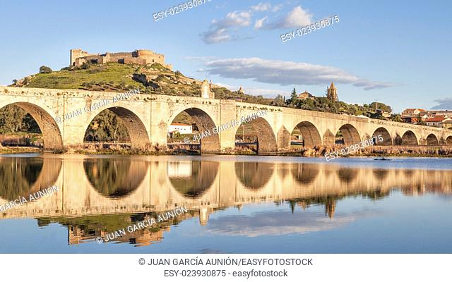 Medellin old bridge and castle from Guadiana riverside, Spain