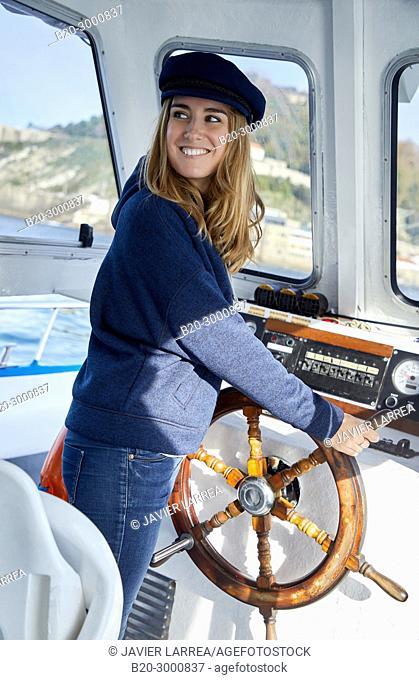 Sailor, Adult woman with rudder on a boat trip to Santa Clara Island, Donostia, San Sebastian, Gipuzkoa, Basque Country, Spain, Europe