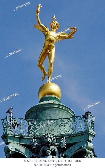 Génie de la Liberté statue on the top of the July Column in Place de la Bastille, Paris, France