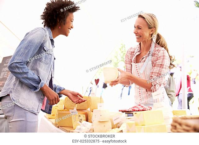 Woman Selling Fresh Cheese At Farmers Food Market